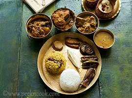 Of all the traditional feasts in India, a thali makes for the perfect assortment of delicious regional dishes on a single platter. The quintessential Indian thali is more like a cultural exploration and makes for a complete meal in itself.